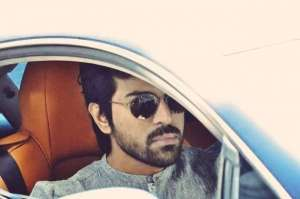 ram-charan-in-his-swanky-aston-martin-car-photos_g2d